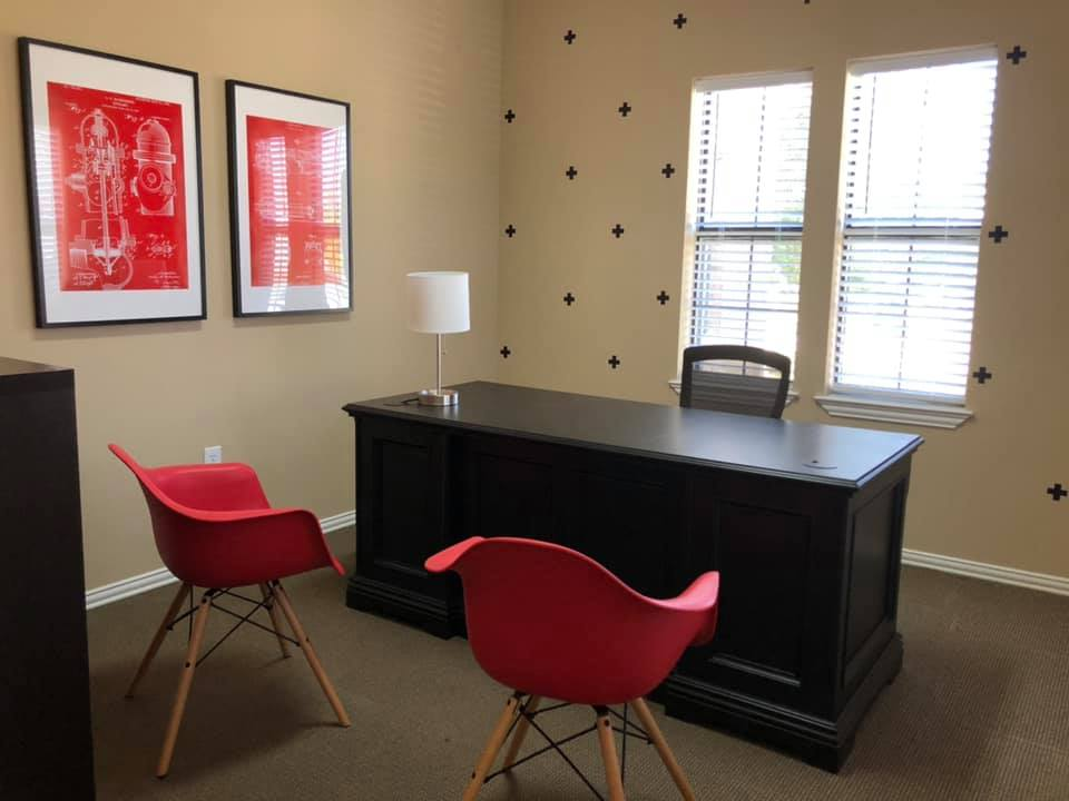 Picture chairs and desk at of office at Red Ladder Roofing & Construction